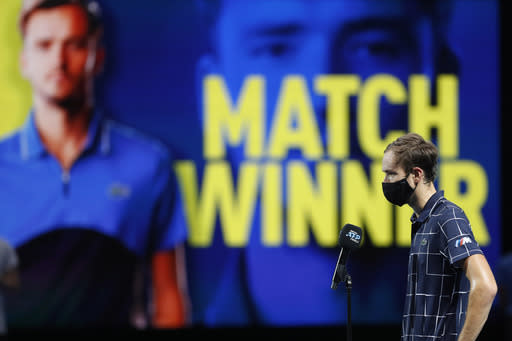Daniil Medvedev of Russia speaks on a microphone after winning against Novak Djokovic of Serbia in tennis match at the ATP World Finals tennis tournament at the O2 arena in London, Wednesday, Nov. 18, 2020. (AP Photo/Frank Augstein)