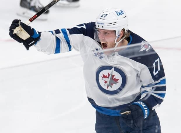 Nikolaj Ehlers celebrates his goal against the Toronto Maple Leafs on Thursday. He was injured when the teams met again on Saturday. (Frank Gunn/The Canadian Press - image credit)