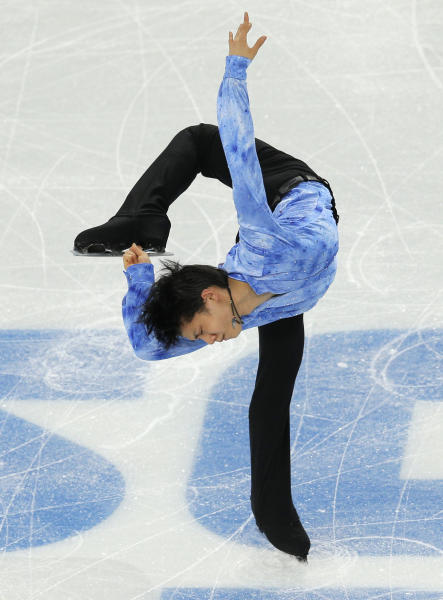 Yuzuru Hanyu of Japan competes in the men's team short program figure skating competition at the Iceberg Skating Palace during the 2014 Winter Olympics, Thursday, Feb. 6, 2014, in Sochi, Russia. (AP Photo/Vadim Ghirda)