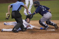 Seattle Mariners catcher Austin Nola, right, tags out Los Angeles Dodgers' Joc Pederson at home plate after a single from Mookie Betts during the second inning of a baseball game Monday, Aug. 17, 2020, in Los Angeles. (AP Photo/Marcio Jose Sanchez)