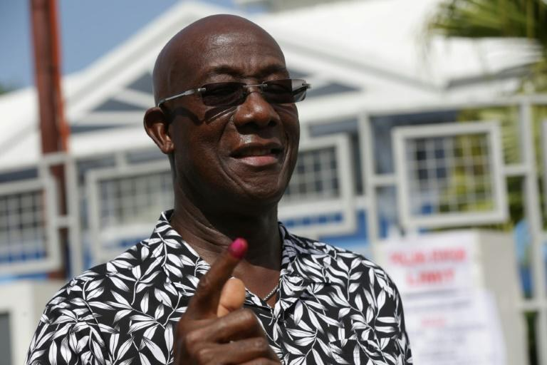 Trinidad and Tobago's Prime Minister Keith Rowley shows the ink mark on his finger after casting his vote in the capital on Monday
