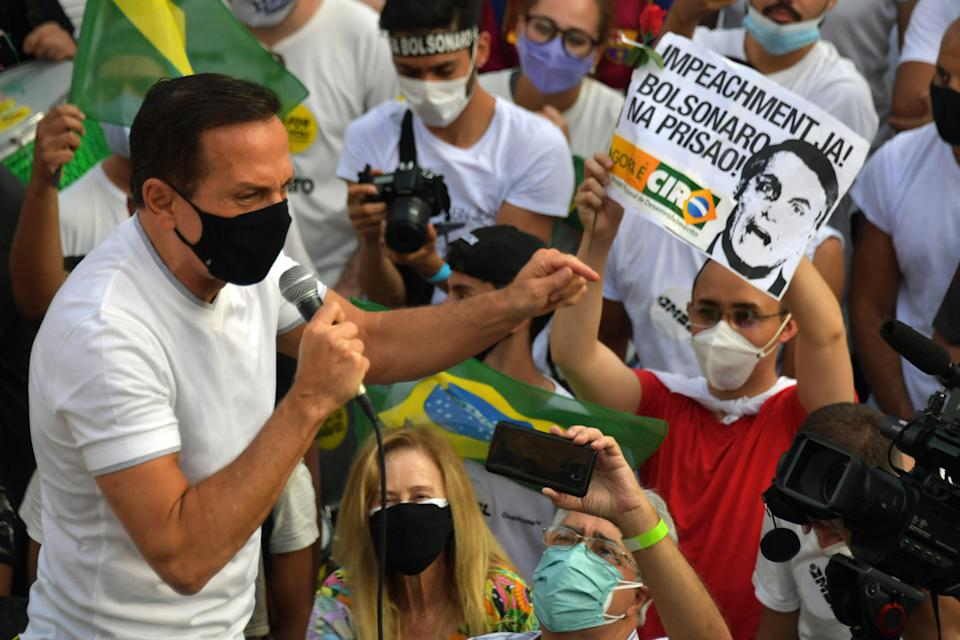 Sao Paulo's governor Joao Doria addresses demonstrators during a protest called by right-wing groups and parties to demand the impeachment of Brazilian President Jair Bolsonaro, in Sao Paulo, Brazil, on September 12 2021. (Photo by NELSON ALMEIDA / AFP) (Photo by NELSON ALMEIDA/AFP via Getty Images)