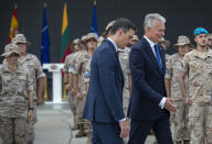 Lithuania's President Gitanas Nauseda, right, and Spain's Prime Minister Pedro Sanchez walk past Spain's soldiers at the Siauliai military air force base some 220 kms (136,7 miles) east of the capital Vilnius, Lithuania, Thursday, July 8, 2021. (AP Photo/Mindaugas Kulbis)