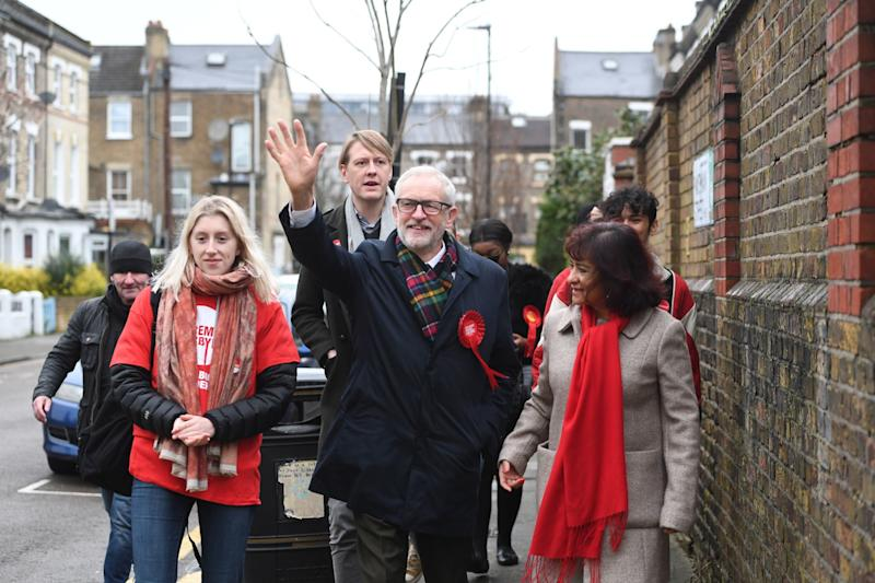 Jeremy Corbyn (centre) and his wife Laura Alvarez (right) arriving to cast their votes in December's General Election (PA)