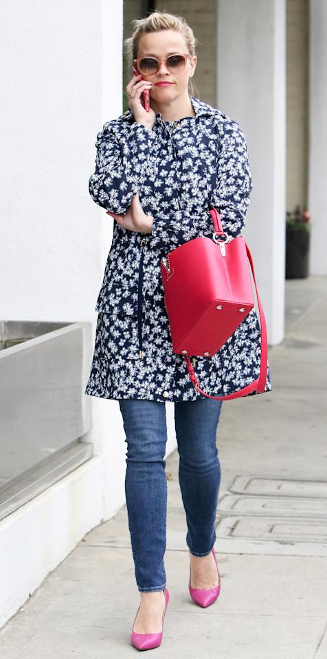 <p>The actress was spotted out in Los Angeles rocking the chicest floral rain jacket we've ever seen. She accessorized her outfit with equally sweet accessories, including oversize sunnies, a vibrant handbag, and pink pumps.</p>