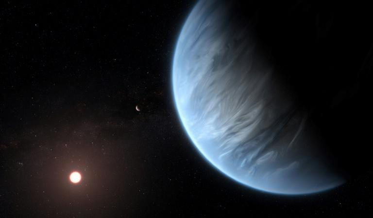 A handout artist's impression released by ESA/Hubble shows the K2-18b super-Earth (AFP Photo/M. KORNMESSER)