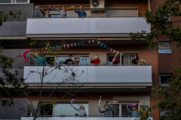 PHOTO: People play instruments as others dance on their balconies in support of the medical staff that are working on the frontlines of the novel coronavirus outbreak, in Barcelona, Spain, on April 5, 2020. (Emilio Morenatti/AP)