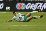 Club Leon's Santiago Colombatto knocks the ball out of the air against the Seattle Sounders during the first half of the Leagues Cup soccer final Wednesday, Sept. 22, 2021, in Las Vegas. (AP Photo/John Locher)