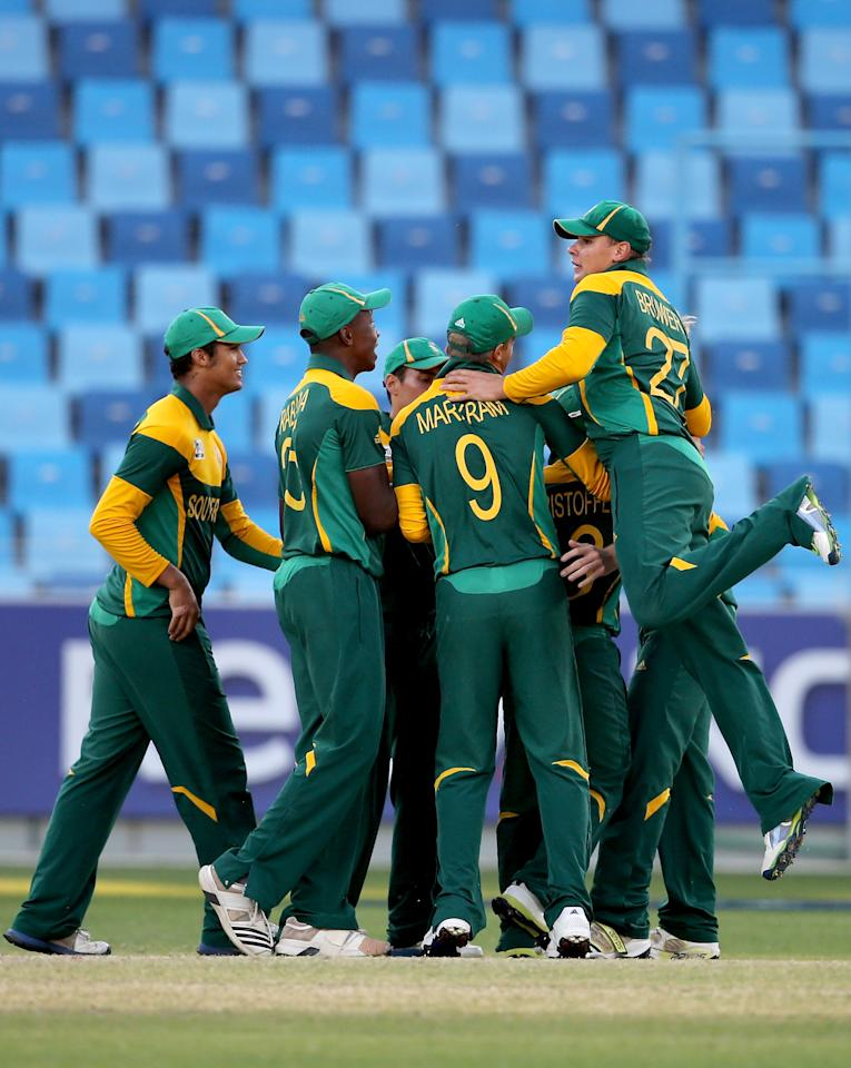 DUBAI, UNITED ARAB EMIRATES - FEBRUARY 26: Players of south Africa celebrate after winning the ICC U19 Cricket World Cup 2014 Semi Final match between South Africa and Australia at the Dubai Sports City Cricket Stadium on February 26, 2014 in Dubai, United Arab Emirates.  (Photo by Francois Nel - IDI/IDI via Getty Images)