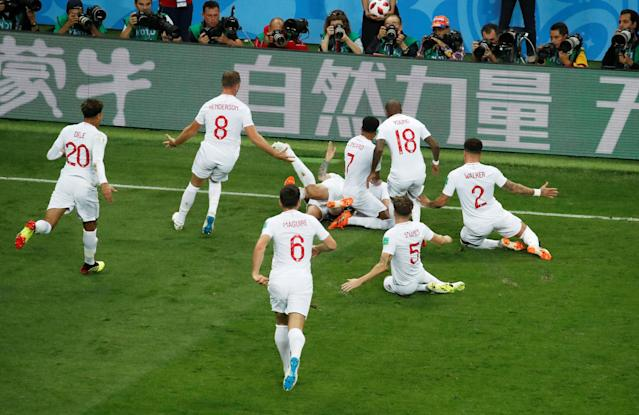 <p>Trippier's teammates mob the England goalscorer </p>
