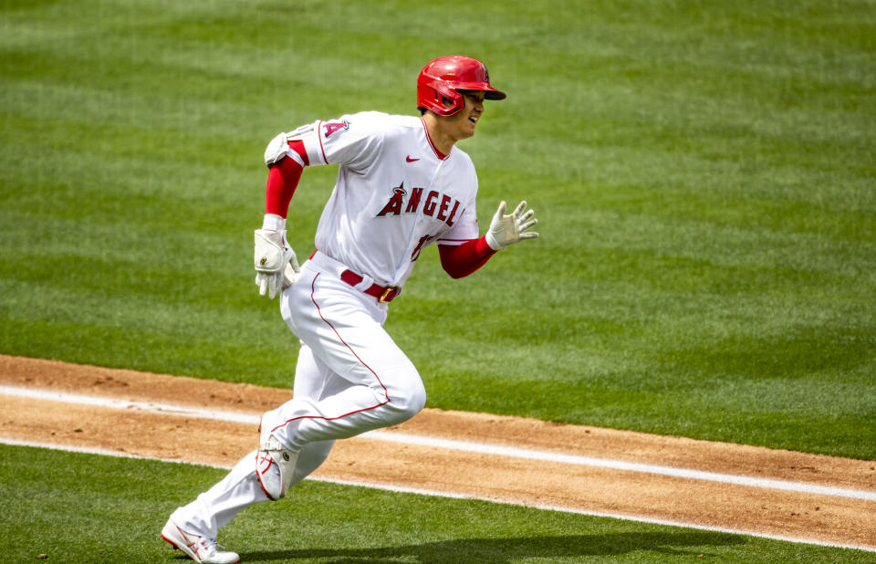 ANAHEIM, CA - APRIL 21, 2021:  Los Angeles Angels designated hitter Shohei Ohtani (17) runs the bases after hitting a solo homer against Texas Rangers starting pitcher Mike Foltynewicz (20) in the 3rd inning  at Angel Stadium on April 21, 2021 in Santa Ana California.(Gina Ferazzi / Los Angeles Times via Getty Images)
