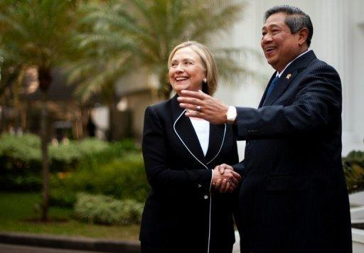 Hillary Clinton (L) stood firm in calling for freedom of navigation in the strategic South China Sea