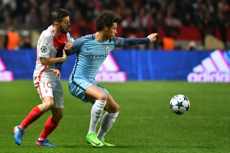 Manchester City's midfielder Leroy Sane (R) challenges Monaco's midfielder Bernardo Silva during the UEFA Champions League round of 16 football match March 15, 2017