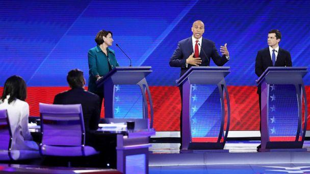 PHOTO: Democratic presidential candidate Sen. Amy Klobuchar and Mayor Pete Buttigieg look on as Sen. Cory Booker speaks during the Democratic Presidential Debate on Sept. 12, 2019, in Houston. (Win Mcnamee/Getty Images)