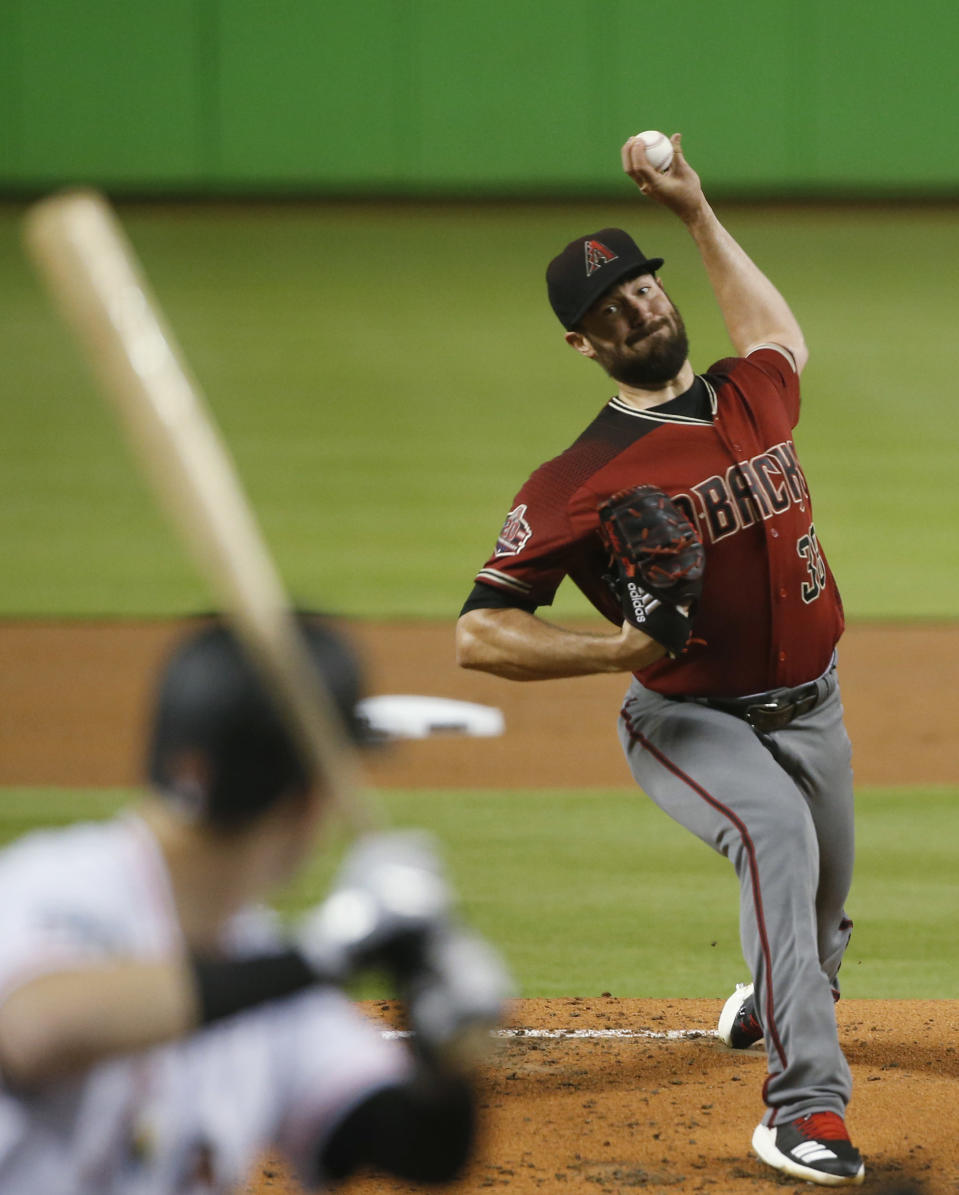Arizona Diamondbacks' Robbie Ray delivers a pitch to Miami Marlins' Brian Anderson during the first inning of a baseball game Wednesday, June 27, 2018, in Miami. (AP Photo/Wilfredo Lee)