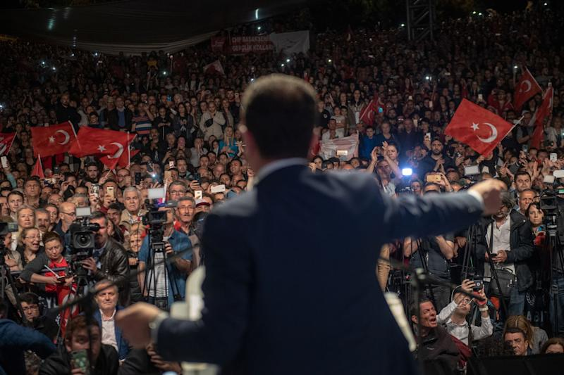"Istanbul Mayor Ekrem Imamoglu gestures as he speaks during a protest against the re-run of Istanbul mayoral election in Istanbul, on May 6, 2019. - Turkey's top election body ordered a re-run of the Istanbul mayoral election on May 6, 2019 after President Recep Tayyip Erdogan's party complained about its shock defeat in the vote, the state news agency reported. The ruling Justice and Development Party (AKP) narrowly lost Turkey's biggest city in March 31 local elections, ending the party and its predecessors' 25-year control of the metropolis. The new election will take place on June 23, according to the state-run TRT broadcaster. The AKP claims there were ""irregularities and corruption"" that required a re-run of the mayoral election, which was won by Ekrem Imamoglu, of the main opposition Republican People's Party (CHP) by just 13,000 votes. (Photo by Bulent Kilic / AFP) (Photo credit should read BULENT KILIC/AFP/Getty Images)"
