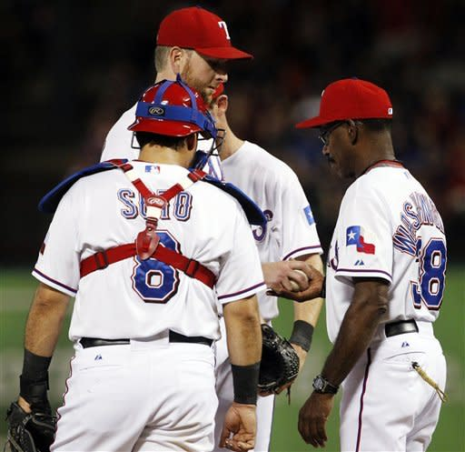 Texas Rangers catcher Geovany Soto (8) watches as manager Ron Washington, right, takes the ball from starter Scott Feldman in the fourth inning of a baseball game against the Oakland Athletics, Tuesday, Sept. 25, 2012, in Arlington, Texas. (AP Photo/Tony Gutierrez)