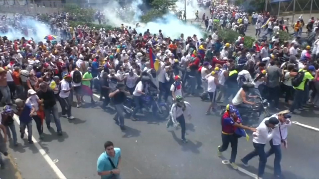two-protesters-shot-dead-as-hundreds-of-thousands-march-against-venezuelan-government