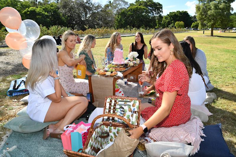 Friends shown celebrating in a picnic in Brisbane on Saturday as restrictions were eased. Source: AAP