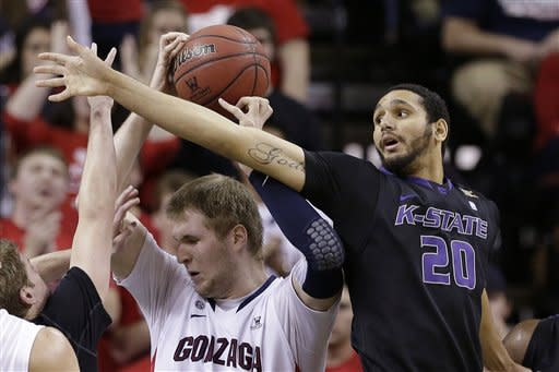 Kansas State's Adrian Diaz (20) misses as he lunges for the ball held by Gonzaga's Przemek Karnowski in the first half of an NCAA college basketball game Saturday, Dec. 15, 2012, in Seattle. (AP Photo/Elaine Thompson)