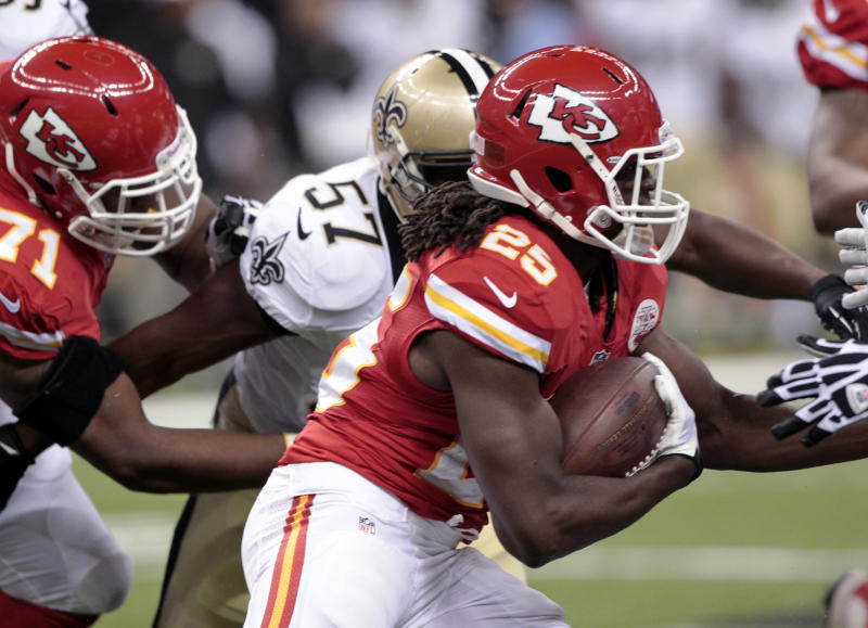 Kansas City Chiefs running back Jamaal Charles (25) carries past New Orleans Saints outside linebacker David Hawthorne (57) during the first half of an NFL preseason football game at the Superdome in New Orleans, Friday, Aug. 9, 2013. (AP Photo/Matthew Hinton)