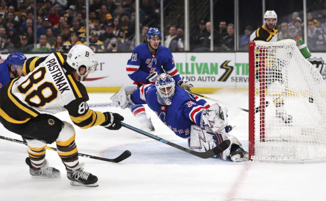 Boston Bruins right wing David Pastrnak (88) beats New York Rangers goaltender Henrik Lundqvist for a goal during the second period of an NHL hockey game in Boston, Wednesday, March 27, 2019. (AP Photo/Charles Krupa)