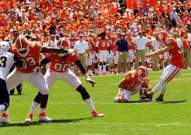 "CLEMSON, SC – SEPTEMBER 2: Wide receiver Will Swinney holds the ball for kicker <a class=""link rapid-noclick-resp"" href=""/ncaaf/players/256784/"" data-ylk=""slk:Greg Huegel"">Greg Huegel</a> #92 of the <a class=""link rapid-noclick-resp"" href=""/ncaab/teams/cbg/"" data-ylk=""slk:Clemson Tigers"">Clemson Tigers</a> as he kicks an extra point against the <a class=""link rapid-noclick-resp"" href=""/ncaab/teams/kae/"" data-ylk=""slk:Kent State Golden Flashes"">Kent State Golden Flashes</a> on September 2, 2017 at Memorial Stadium in Clemson, South Carolina. (Photo by Todd Bennett/Getty Images)"
