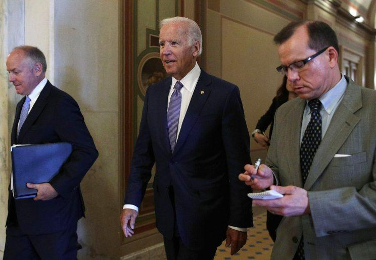Former Vice President Joseph Biden, center, leaves after meeting with Senate Minority Whip Sen. Richard Durbin, D-Ill., at the Capitol on July 11, 2017, in Washington, D.C. Biden was on the Hill to meet senators about his National Cancer Moonshot initiative. (Photo: Alex Wong/Getty Images)