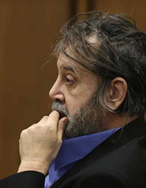 Bobby Thompson, who authorities have identified as Harvard-trained attorney John Donald Cody, listens during closing statements by the prosecution Wednesday, Nov. 13, 2013, in Cleveland. Thompson is charged with looting the United States Navy Veterans Association, a charity he ran from Tampa, Fla. The charity fraudulently registered with the state of Ohio in 2003 and made annual renewals, the prosecutor said. The charges include racketeering, money laundering, theft and identity theft.(AP Photo/Tony Dejak)