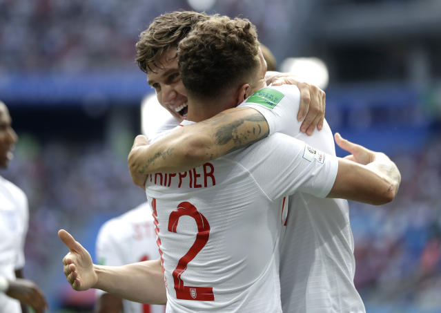 <p>England's John Stones is congratulated by teammate Kieran Trippier after scoring his team's first goal </p>