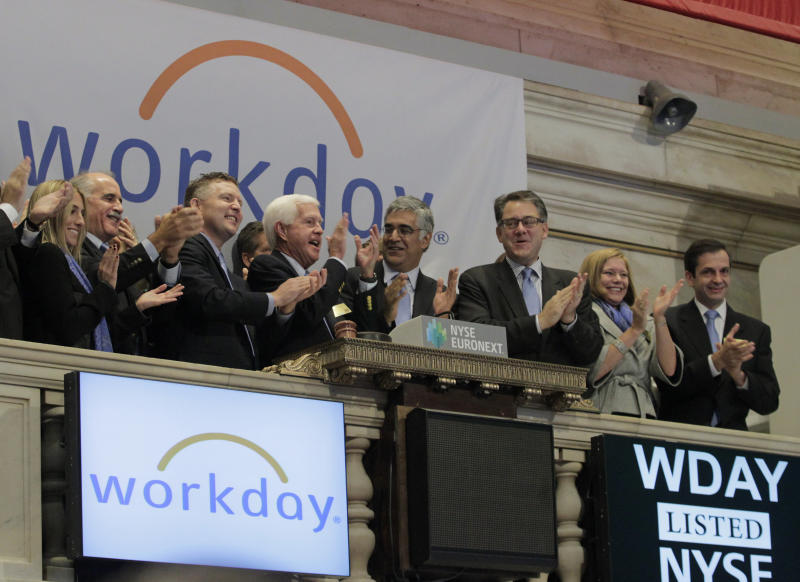 Workday Inc. Chairman, Co-Founder and Co-CEO Aneel Bhusri (center R) and Co-Founder and Co-CEO Dave Duffield (center L) ring the opening bell with company executives in celebration of the company's IPO at the New York Stock Exchange, October 12, 2012. Shares of Workday Inc. soared 72 percent in their market debut on Friday, as the market for enterprise software continues to hold strong. The Pleasanton, California-based company, considered a leader in the cloud computing sector, opened New York Stock Exchange trading at $48.05 after pricing shares above the expected range at $28.00. It sold 22.75 million shares, raising $637 million. REUTERS/Brendan McDermid (UNITED STATES - Tags: BUSINESS)