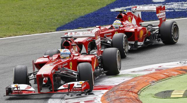 Ferrari Formula One driver Fernando Alonso of Spain drives ahead of team mate Felipe Massa of Brazil during the Italian F1 Grand Prix at the Monza circuit September 8, 2013. REUTERS/Stefano Rellandini (ITALY - Tags: SPORT MOTORSPORT F1)