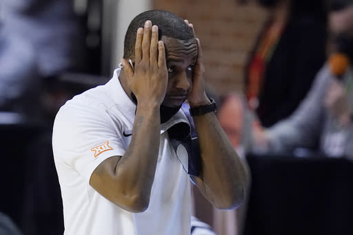 Oklahoma State head coach Mike Boynton Jr. reacts to a call by an official in the second half of an NCAA college basketball game against Baylor, Saturday, Jan. 23, 2021, in Stillwater, Okla. (AP Photo/Sue Ogrocki)