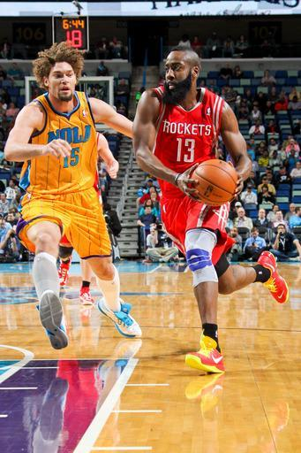NEW ORLEANS, LA - JANUARY 25: James Harden #13 of the Houston Rockets drives against Robin Lopez #15 of the New Orleans Hornets on January 25, 2013 at the New Orleans Arena in New Orleans, Louisiana. (Photo by Layne Murdoch/NBAE via Getty Images)