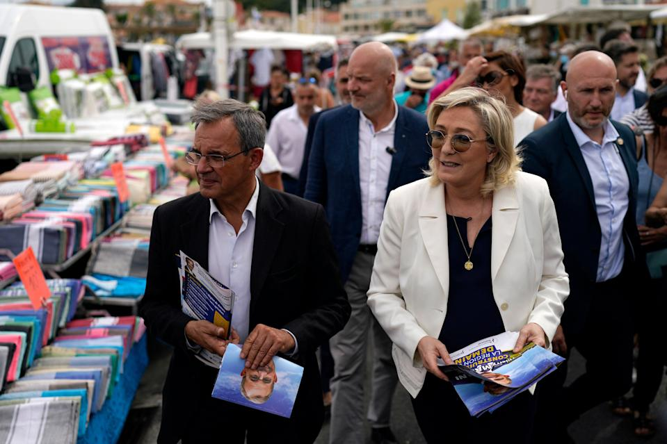 Far-right leader Marine le Pen, right, and local candidate Thierry Mariani, left, campaign in Six-Fours-les-Plages, southern France (Copyright 2021 The Associated Press. All rights reserved)