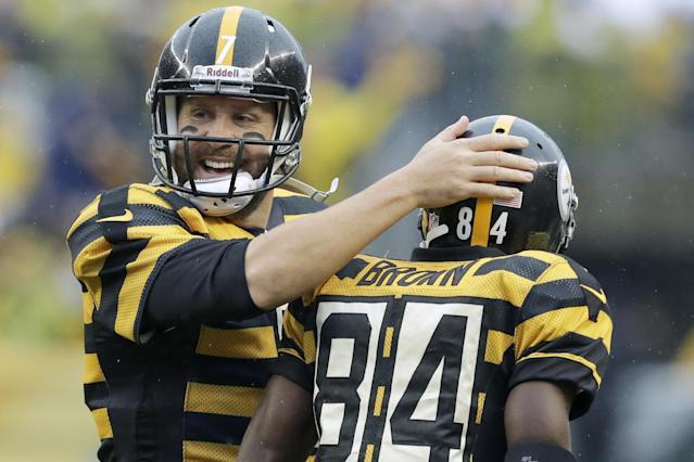 Pittsburgh Steelers quarterback Ben Roethlisberger (7) celebrates with wide receiver Antonio Brown (84) after the two connected for a touchdown catch in the first half of an NFL football game against the Detroit Lions in Pittsburgh, Sunday, Nov. 17, 2013. (AP Photo/Gene J. Puskar)