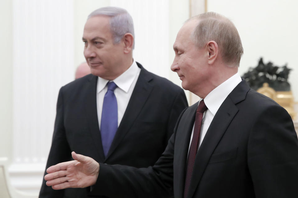 Russian President Vladimir Putin, right, welcomes Israeli Prime Minister Benjamin Netanyahu for the talks in the Kremlin in Moscow, Russia, Wednesday, Feb. 27, 2019. The talks are expected to focus on the situation in Syria. (Maxim Shemetov/Pool Photo via AP)