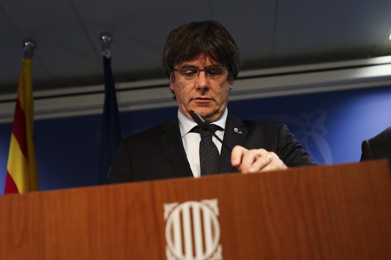 Catalonia's former regional president Carles Puigdemont arrives to give a statement in Brussels, Monday, Oct. 14, 2019. A dozen Catalan politicians and activists have been convicted on charges of sedition, misuse of public funds and disobedience for their role in an illegal and failed secession attempt for the northeastern region of Spain in 2017. (AP Photo/Francisco Seco)