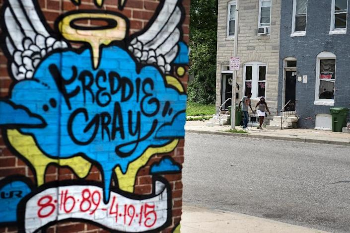 A mural honoring Freddie Gray near where he was arrested, on June 23, 2016 in Baltimore, Maryland (AFP Photo/Brendan Smialowski)