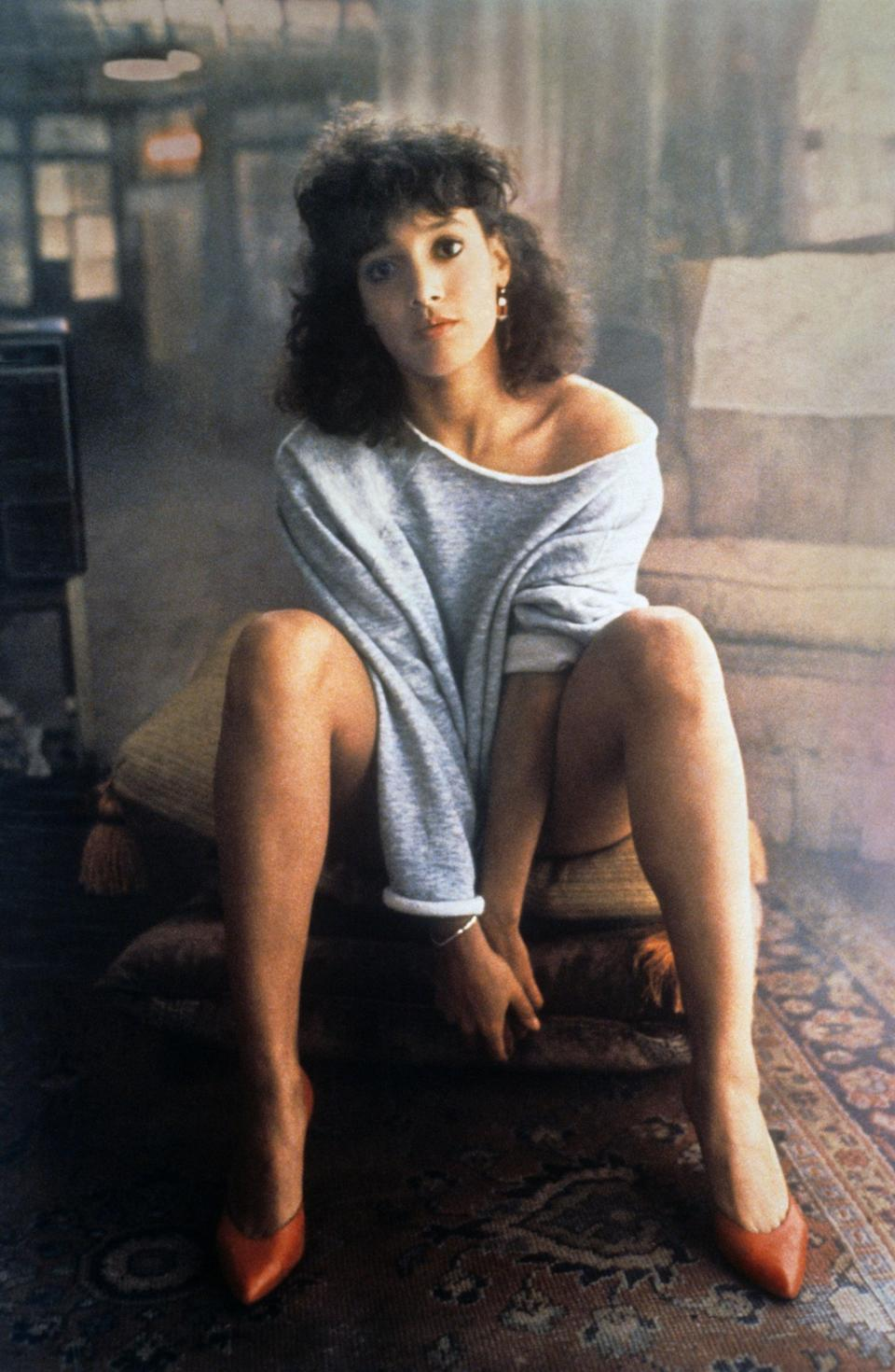 <p>Jennifer Beals got to wear what, to this day, still looks like the most comfortable sweatshirt ever - at least in my opinion. She wore this raglan cut sweatshirt in typical '80s style, off the shoulder with bright pumps.</p>