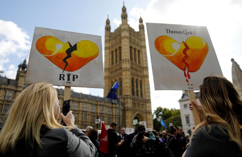 Ex-Thomas Cook employees demonstrate in London on October 2, 2019, after delivering a petition calling on the Government to open a full inquiry into Thomas Cook's collapse and for the company's directors to pay back their bonuses. - British travel firm Thomas Cook collapsed on September 23, leaving hundreds of thousands of holidaymakers stranded and sparking the UK's biggest repatriation since World War II. (Photo by Tolga AKMEN / AFP) (Photo by TOLGA AKMEN/AFP via Getty Images)