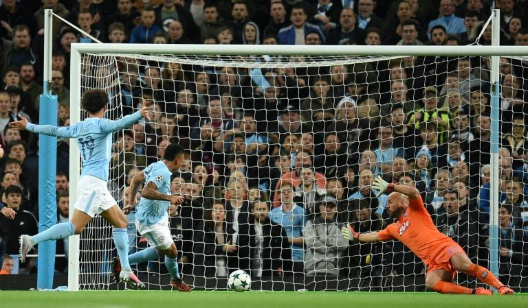 Manchester City's striker Gabriel Jesus (2ndL) scores his team's second goal against Napoli on October 17, 2017