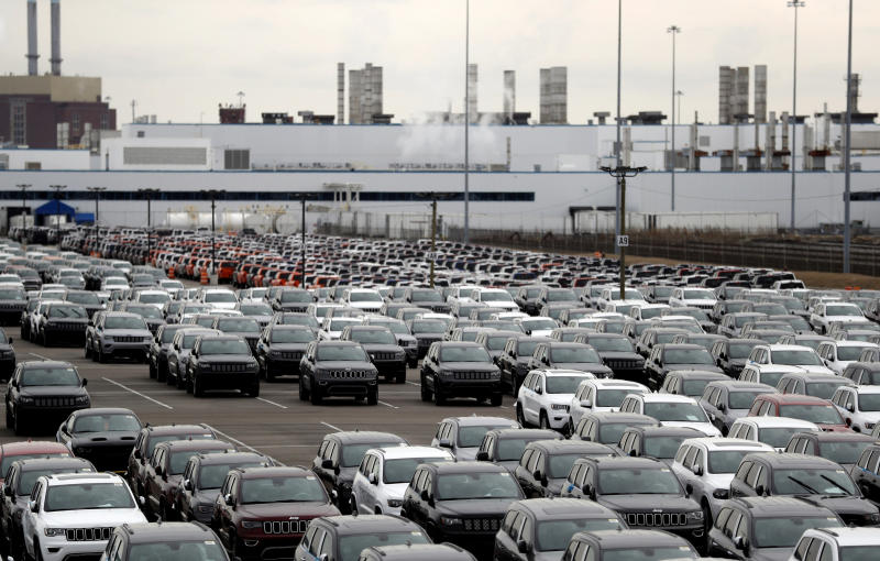 FILE- In this Feb. 26, 2019 file photo, Jeep vehicles are parked outside the Jefferson North Assembly Plant in Detroit. Fiat Chrysler can move forward with plans to build a new, $1.6 million assembly plant on Detroit's Eastside and invest $900 million to retool and modernize another. The Detroit City Council on Tuesday approved land deals and community benefits agreements tied to the project. They include a four-week exclusive window Detroit residents will have to apply for jobs at the facilities once laid-off workers and temporary employees are considered. Fiat Chrysler expects to add 4,950 new jobs. (AP Photo/Carlos Osorio, File)