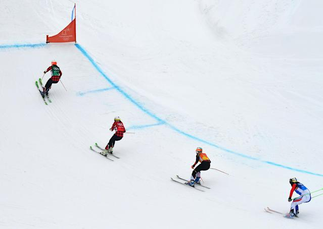 """Freestyle Skiing - Pyeongchang 2018 Winter Olympics - Women's Ski Cross Finals - Phoenix Snow Park - Pyeongchang, South Korea - February 23, 2018 - Kelsey Serwa of Canada, Brittany Phelan of Canada, Sanna Luedi of Switzerland and Alizee Baron of France compete. REUTERS/Dylan Martinez SEARCH """"OLYMPICS BEST"""" FOR ALL PICTURES. TPX IMAGES OF THE DAY."""