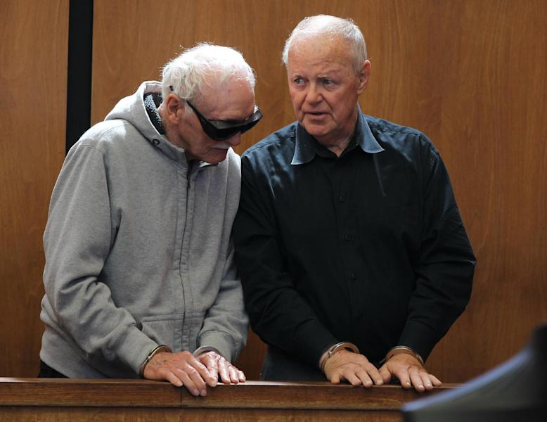 """Howard """"Howie"""" Winter, left and James Melvin talk after their arraignment at Somerville District Court on Friday, June 8, 2012 in Somerville, Mass. Winter, 83, and Melvin, 70, were arrested Thursday after authorities said they tried over several months to extort $35,000 from each of two men who had arranged a $100,000 loan for a third man. Both men pleaded not guilty to attempted extortion and conspiracy charges. Winter is the former head of the Winter Hill Gang, that was later run by James """"Whitey"""" Bulger. (AP Photo/The Boston Globe, Jonathan Wiggs, Pool)"""