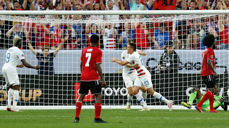 United States 6 Trinidad and Tobago 0: Defending champs reach quarters with rout