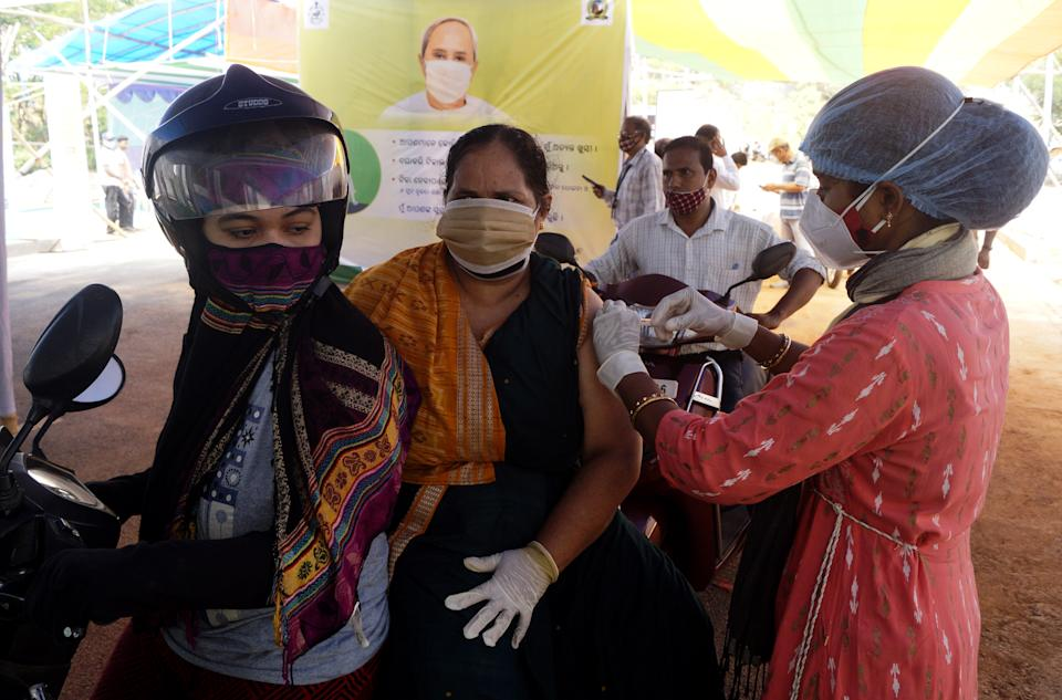 Senior citizens above 45 years old vaccinated in the drive-in vaccination program by the city municipality in the eastern Indian state Odisha's capital city Bhubaneswar on May 12, 2021.  (Photo by STR/NurPhoto via Getty Images)