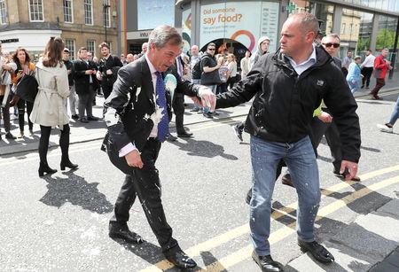 Brexit Party leader Nigel gestures after being hit with a milkshake while arriving for a Brexit Party campaign event in Newcastle, Britain, May 20, 2019. REUTERS/Scott Heppell