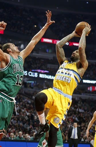 Denver Nuggets guard Wilson Chandler (21) shoots over Chicago Bulls center Joakim Noah (13) during the first half of an NBA basketball game, Monday, March 18, 2013, in Chicago. (AP Photo/Charles Rex Arbogast)