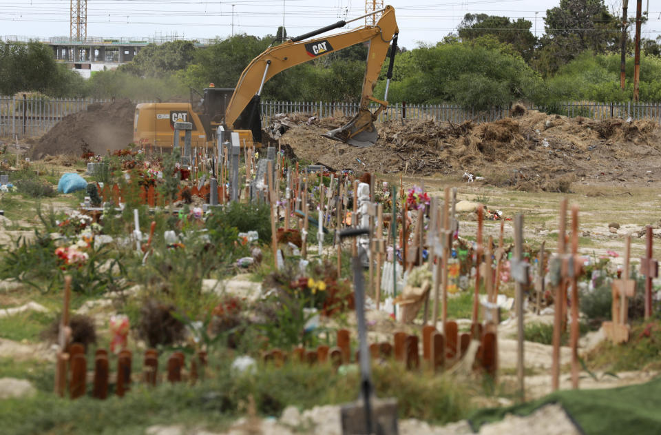 Land is excavated to make way for more burial space in the Maitland cemetery in Cape Town, South Africa, Tuesday, Jan. 19, 2021. The City of Cape Town is working closely with the Muslim Judicial Council to increase burial capacity as COVID-19 claims more lives in a second surge of the pandemic. (AP Photo/Nardus Engelbrecht)